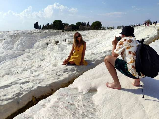 Visitors to Turkey's thermal spring Pamukkale lift sector's hopes